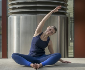 Hansa Yoga, Katharina Rodewald, Forrest Yoga ® Neck release pose with feet in Baddha Konasana